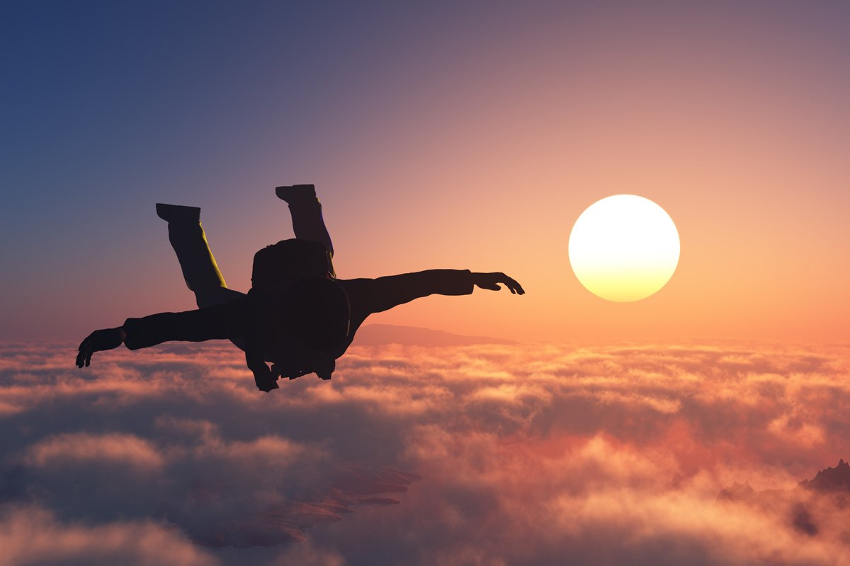 skydiver at dusk
