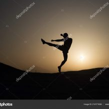 Hit your goal. Silhouette man motion jump in front of sunset sky background. Daily motivation. Healthy lifestyle personal achievements goals and success. Future success depends on your efforts now.